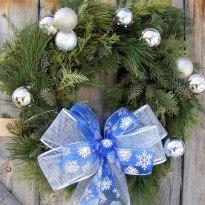 fresh evergreen wreath blue snowflake bow