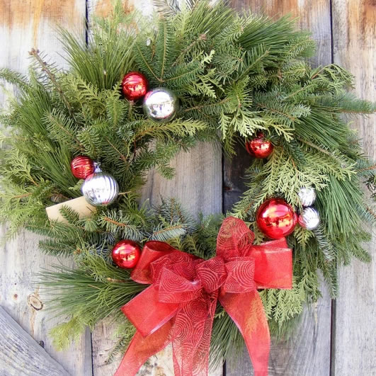 fresh evergreen wreath red bow
